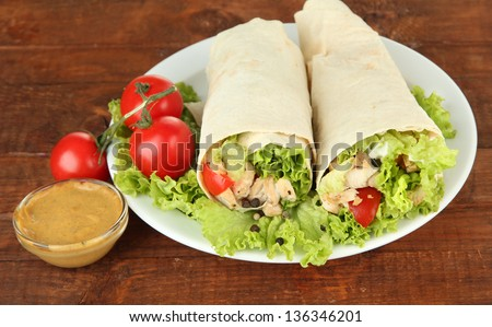 Kebab - grilled meat and vegetables, on plate, on wooden background