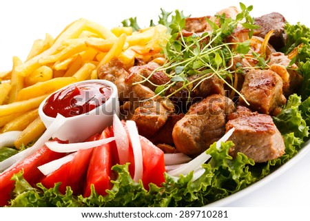 Kebab - grilled meat with French fries and vegetables