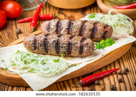 kebab meat with sauce on a wooden table