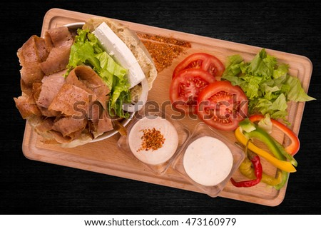 Kebab With Cheese, Sauce, Tomatoes And Salad On Black Background