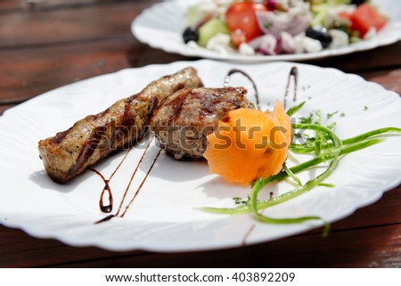 Kebapche and  kyufte - a traditional Bulgarian dish of grilled minced meat with spices. - stock photo