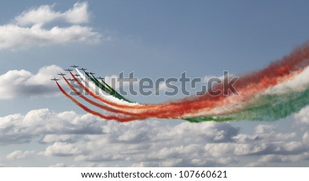 KECSKEMET, HUNGARY - AUGUST 7: the aerobatic display team named Frecce Tricolori flies at the International Air and Military Show on August 7, 2010 in Kecskemet, Hungary - stock photo