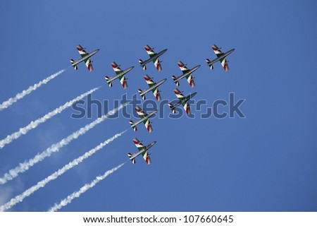 KECSKEMET, HUNGARY - AUGUST 7: the aerobatic display team named Frecce Tricolori flies at the International Air and Military Show on August 7, 2010 in Kecskemet, Hungary