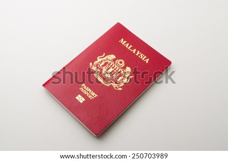 Kedah, Malaysia - January 22, 2015 : Malaysian Passport. Malaysian passport is an international pass to cross over another country.  - stock photo