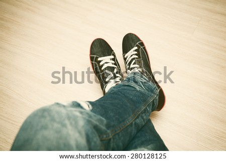 Keds and jeans, youth shoes - stock photo
