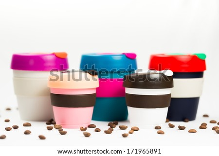 Keep cup on white background with coffee beans - stock photo