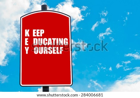 Keep Educating Yourself motivational quote written on red road sign isolated over clear blue sky background. Concept  image with available copy space - stock photo