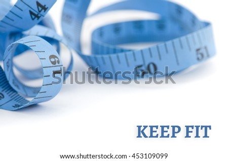Keep fit, health concept, close up & selective focus of blue measuring tape, isolated on white background