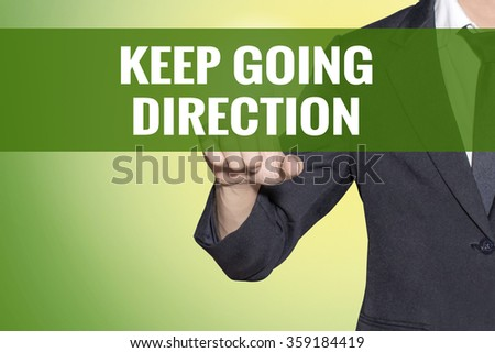 Keep Going direction word Business man touch on vintage yellow green tab virtual screen - stock photo