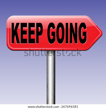 keep going or moving don't quit or stop continue don't give up sign  - stock photo