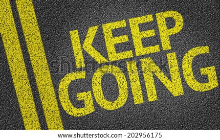 Keep Going written on the road - stock photo