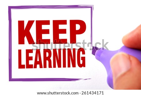 Keep learning text is signed by marker on white paper. - stock photo