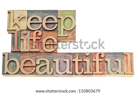 keep life beautiful  - isolated text in vintage letterpress wood type stained by color inks