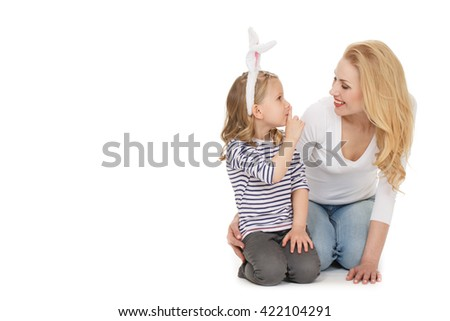 Keep my secret. Shot of a little cheerful girl showing shushing gesture to her smiling mother copyspace on the side isolated on white. - stock photo