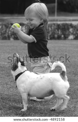 Keep you eye on the ball, selective color, boy and his dog - stock photo