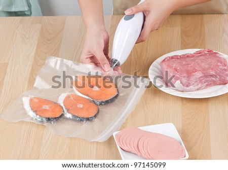 Keep your food always fresh by vacuum packing machine - stock photo