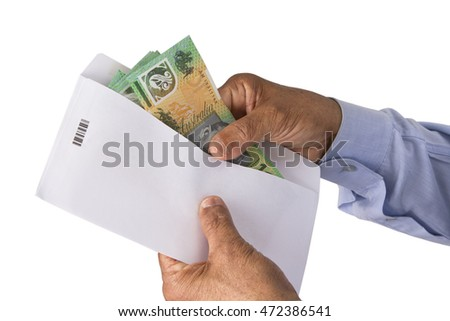 Keeping Australian dollars money in envelope on a white isolated background.