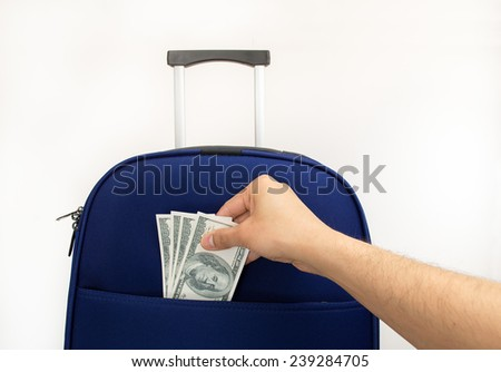 keeping dollars in your suitcase for your next trip - stock photo