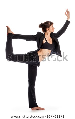 Keeping fit for business. Woman in dance yoga pose. Shot in studio isolated on white. - stock photo