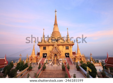 Keereewong temple or Watkeereewong located in Nakornsawan of Thailand , Beautiful pagoda in temple with twilight sky and beautiful light , golden temple with beautiful  sky and  cloud  - stock photo