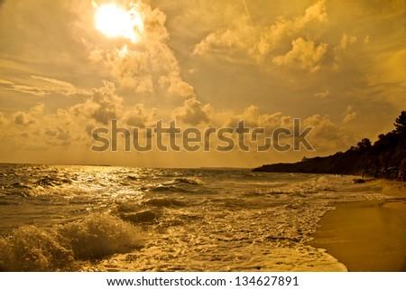 Kefalonia, yellow glow on beach - stock photo