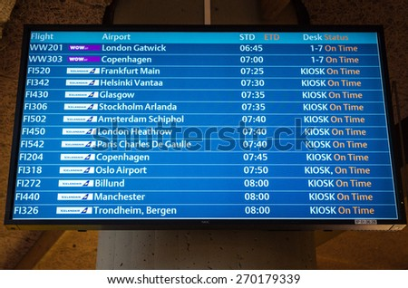 KEFLAVIK, ICELAND - March 15, 2015: Airport departure board screen at Keflavik International Airport - stock photo