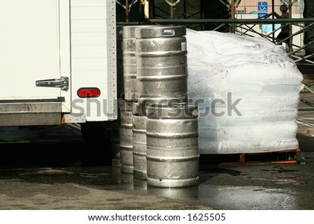 Kegs and ice being delivered to an event - stock photo