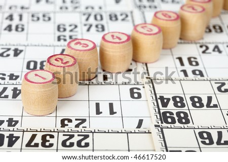 Kegs for bingo on white cards background