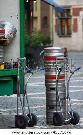 Kegs on a sack barrow of a beer retailer in Antwerp, Belgium. - stock photo