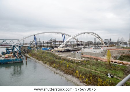 KEHL, GERMANY - DEC 4, 2015: Installation and construction process of the new tramway, pedestrians and bike bridge between Germany and France over the Rhine river
