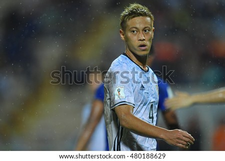 Keisuke Honda (white) of japan in action during the 2018 World Cup Qualifiers match between Thailand and Japan at Rajamangala Stadium on September 6, 2016 in Bangkok, Thailand