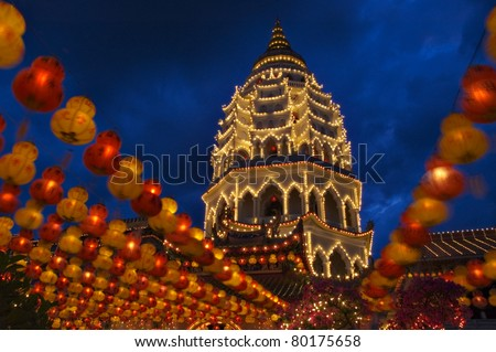 Kek Lok Si Buddhist Temple in Penang, Malaysia, decorated with red lanterns during Chinese New Year - stock photo