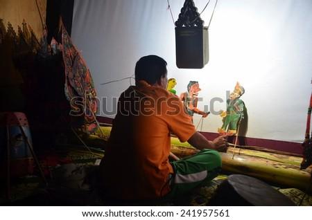 KELANTAN, MALAYSIA - NOVEMBER 18 : The Traditional Malaysian Shadow Puppet Show (Wayang Kulit) by Pak Daim performing during a sahabat media visited November 18, 2014 in Kelantan Malaysia. - stock photo