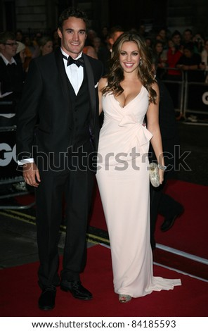 Kelly Brook and Thom Evans arriving for the 2011 GQ Awards, Royal Opera House, London. 06/09/2011  Picture by: Alexandra Glen / Featureflash