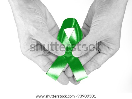 Kelly Green Ribbon a Symbol of Kidney Cancer - stock photo