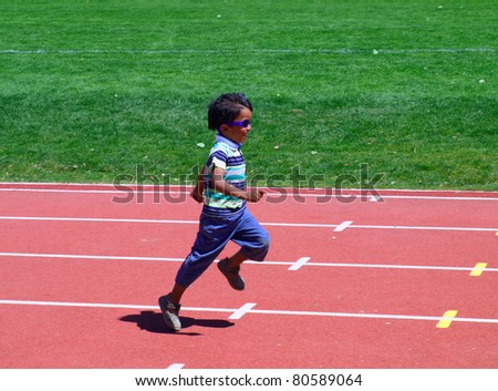 KELOWNA, CANADA - JULY 3:  unidentified child on fun run on 27th Annual Jack Brow Memorial Track and Field Meet July 3, 2011, Kelowna, Canada - stock photo
