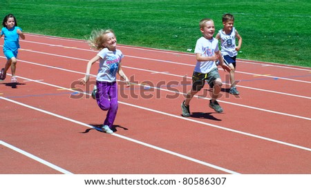 KELOWNA, CANADA - JULY 3:  unidentified children on fun run on the 27th Annual Jack Brow Memorial Track and Field Meet July 3, 2011, Kelowna, Canada - stock photo