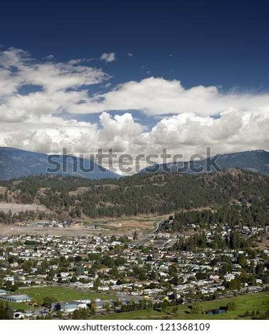 Kelowna neighbourhood with a golf course and Mountains - stock photo