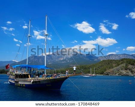 Kemer,Turkey- June 16, 2013: Pirate tourist ship with tourists from around the floats on the Mediterranean Sea along the coast on a tour of Turkey