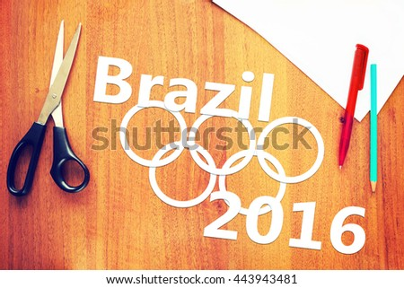 KEMEROVO, RUSSIA - JUNE, 25, 2016. Paper scraps about Olympic Games. Abstract conceptual image of Olympics in Brazil - stock photo