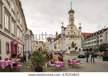 KEMPTEN, GERMANY - JUNE 9: People at the historic town hall of Keptem, Germany on June 9, 2017. Kempten is one of the oldest cities of Germany.