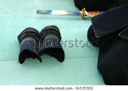 Kendo equipment (japanese fencing); People preparing to fight; - stock photo