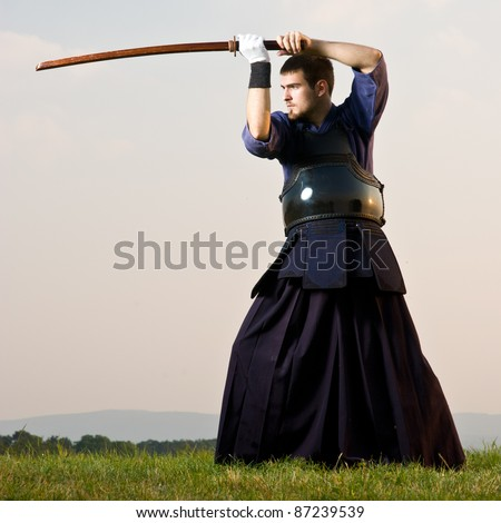 kendo fighter with bokken - stock photo