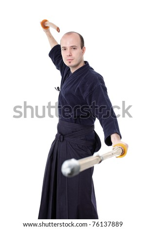 kendo fighter with bokken and shinai isolated on white