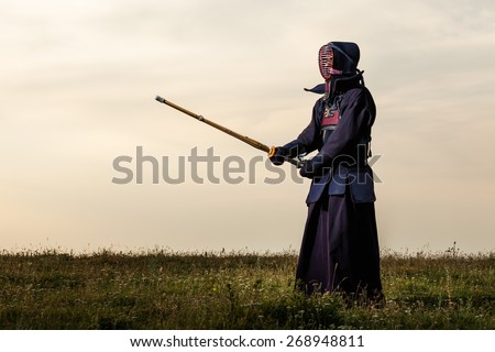 Kendo fighter with shinai - stock photo