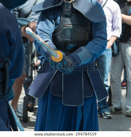 Kendo Fighters match in Traditional Clothes and Bamboo Sword, Japanese Martial Art - stock photo