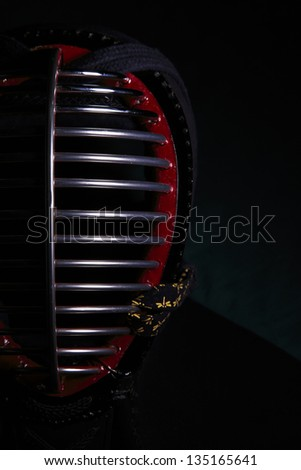Kendo mask in dark background - stock photo