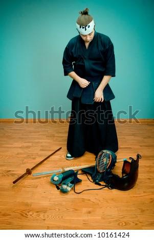 Kendo master with sword - japan martial art concept - stock photo
