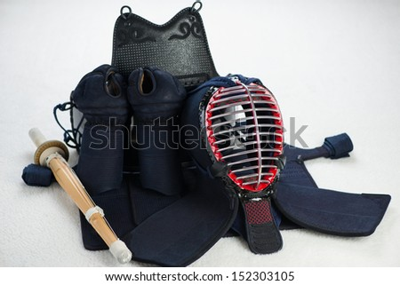 Kendo protective sportswear and shinai, horizontal shot - stock photo