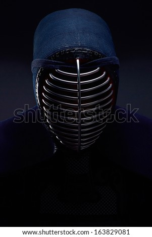 Kendo protective sportswear men, black background - stock photo